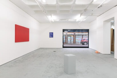 white plinth, red canvas and blue framed installation