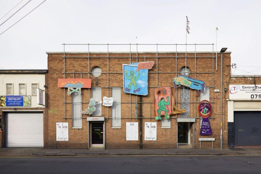 A building with artwork covering its walls