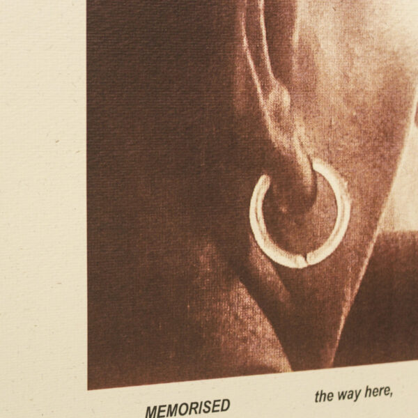 A closeup of the image on the edition - focusing in on the earring