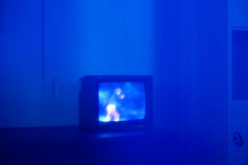 A tv monitor, in a blue haze.
