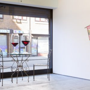 Amanda Ross-Ho Warm Wine (Pinot Noir), 2014 Two lead-free crystal glasses, urethane 106.7 x 50.8 cm Courtesy of The Approach, London  George Little Wipedown 3, 2015 Oil, spray and acrylic paint, Jesmonite, PVC tablecloth, cast iron, brass, pine, hardwood and stains Dimensions variable  Photo: Tim Bowditch