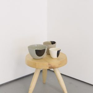 Celine Condorelli Deodand, 2014 Dipped porcelain bowls 8 x 7 cm  Mike Cooter Charlotte Perriand stool ('Tabouret Berger'), 2015 Unvarnised, uncut, European Ash. Designed c. 1953, refabricated to orginal specifications (2015) 32.4 diameter (35.8 at base) cm x 27 cm  Photo: Tim Bowditch