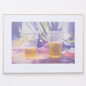 framed print of two cups containing liquid