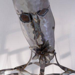 A metallic human head and neck