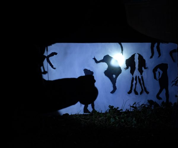 Shadow puppets on a blue background.