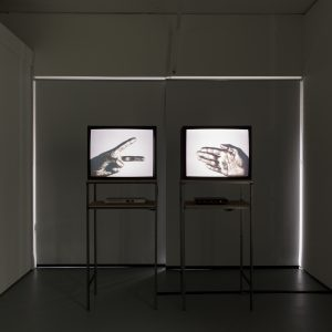 two screens showing a hand in a flat pose and another in a scissors pose