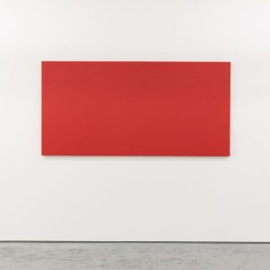 red canvas hung on a white wall