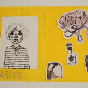 A black and white self portrait on a bright yellow background, hanging on the wall.
