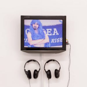 blue haired cheerleader on a screen