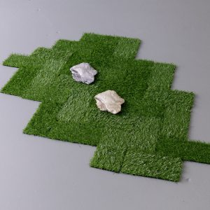 squares of turf with two rocks placed on top