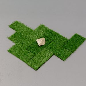 squares of turf with rock placed on top
