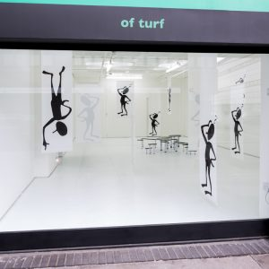 view of Black human figures through a window