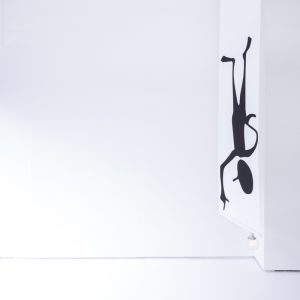 Black human figure hanging upside down