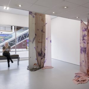hanging pink fabric with purple prints
