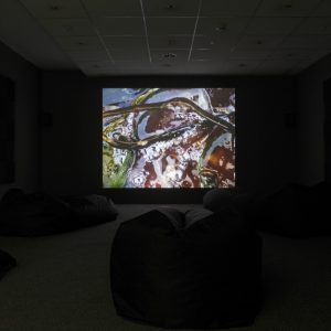 a bold projector screen in a dark room