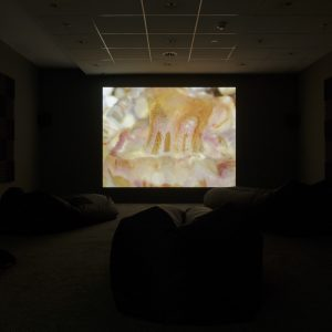 a yellow projector screen in a dark room